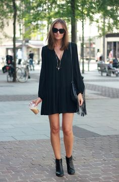 Try our Scoundrel Boots with a black loose fit dress to get this great Fall transition look.