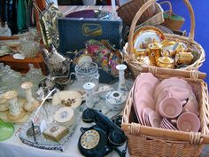 use baskets to display like-things & sets at car boot sale