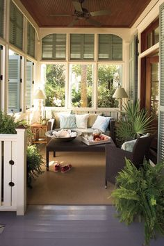 Front Porch Living. Charming front porch multi-functions as a welcoming foyer and relaxing sitting area perfect for enjoying these Spring and Summer nights. Full of character, we love the wood ceiling and painted seaside blue shutters, giving visual depth that's full of coastal charm.
