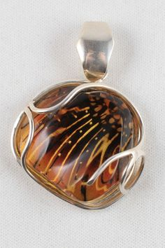 Carved Baltic amber and sterling pendant