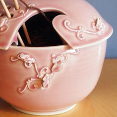 Design is piped on with cake decorating bag and tip.      yarn bowl....soooooo sweet!!!!