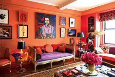 Zac Posen and Christopher Niquet's Manhattan living room is a riot of rich color. The exuberant, collected objects complement the lush roses, regularly delivered by master florist Zezé. The suspended gallery walls are centered by an amethyst recamier. - Photographed by Jason Schmidt, Vogue Met Gala Special Edition 2014