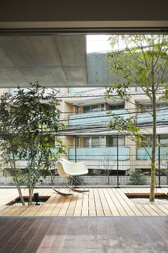 Four-storey house with tree-lined balconies by Ryo Matsui Architects