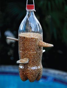 "Nothing says ""come to my garden"" quite like providing food for our feathered friends. Here's an easy DIY project for the kids to make on a weekend, and they can use materials that you already have in the home. http://www.easydiy.co.za/index.php/garden/585-recycled-plastic-bottle-bird-feeder"