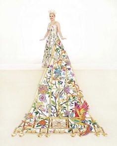 Lacey Marguerite Thurmond, Duchess of Delicate Winged Beauty: This gown and train are covered with clear sequins and rhinestones. A gold sequined bird cage outlined with a rhinestone chain is appliquéd to the gown and train, the latter featuring Christopher Columbus' Santa Maria, Nina and Pinta ships. She is the daughter of Ms. Lisa Rogers Thurmond and Mr. Jimmie Victor Thurmond III. Photo: Courtesy Gary Stanko, Billo Smith Photography