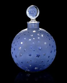 René Lalique for Worth 'Dans La Nuit' a Large Perfume Bottle and Stopper, design 1924 heightened with blue staining 25cm high