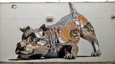 ALLPE Medio Ambiente Blog Medioambiente.org : Un perro de metal atrapado en una pared de piedra
