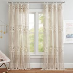 Bring a boho touch to your space with our macramé panel, hand woven from sustainably sourced cotton yarn. Inspired by vintage designs, the diamonds and fringe layer soft detail over a window or on a wall. Boho Curtains, Macrame Curtain, Teen Curtains, Bohemian Headboard, Cortinas Boho, Pottery Barn Teen, Decorative Panels, Girls Bedroom, Boho Teen Bedroom