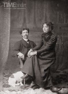 Interesting and mysterious photograph ~ It is a remarkably relaxed studio photograph for the time. The petit young woman is obviously perched on the man's knee, her hands clasped on her own knee, only a slightly bemused expression on her face – not really looking at the camera. The suavely dressed gentleman looks directly at the photographer with not the faintest concern about striking a pose, a cigarette between his fingers. Are they engaged or married?  ~ written by Timebinder