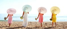 Parasols are a great way to keep the sun off of you and your wedding guests when you're having a Key West beach wedding...  #parasol #beachwedding #sunoff