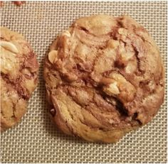Soft and gooey Nutella swirl peanut butter cookies with chocolate chunks and peanuts! Your going to need milk with these.....