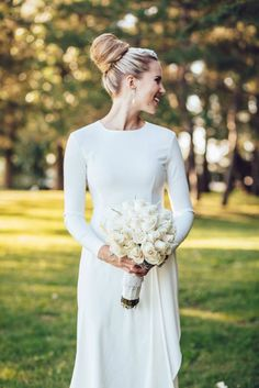 Modest and minimalist long sleeve wedding dress   http://www.weddingpartyapp.com/blog/2014/09/02/45-long-sleeved-wedding-dresses-for-fall-brides/