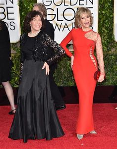 Lily Tomlin and Jane Fonda arrive at the 72nd annual Golden Globe Awards at the Beverly Hilton Hotel in Beverly Hills, Calif., on Jan. 11, 2015.
