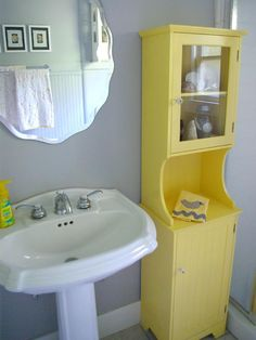 Yellow Cabinet  & Mirror  {Oleander and Palm: Grey and Yellow Bathroom Redo.}