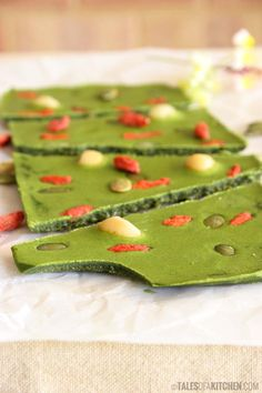 Green chocolate bark loaded with superfoods. It's soft, creamy tasting, with a slight lemony aftertaste. Also crunchy from the macadamia nuts, pepitas and goji berries. You must!