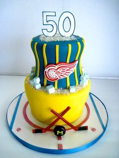 Very cool Detroit Red Wings hockey cake  I'll take this for my #50, but you can forget the blue and gold... GO MSU!!!