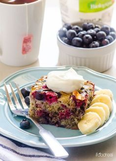 Berry Banana Quinoa and Steel Cut Oats Breakfast Bake 1/2 C quinoa, uncooked 1/2 C steel cut oats, uncooked 3 med very ripe bananas, sliced 1 + 1/2 C blueberries 1/2 C raspberries 1/4 C unsweetened coconut flakes, toasted (optional) 2 C milk  2 lg eggs 1 scoop protein powder (optional)** 1 - 2 T maple syrup*** (skip if adding sweetened protein powder) 1 t pure vanilla extract 1/2 t cinnamon Dash of salt Cooking spray Non-fat Greek yogurt, for topping (optional)