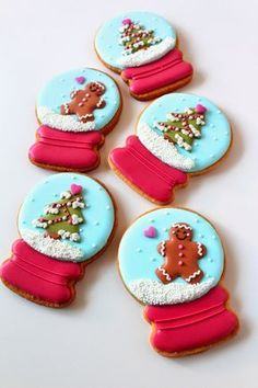 Bake these cute gingerbread Christmas snow globe cookies decorated with pretty icing for your holiday party!