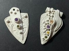 Silver clay with stone settings.