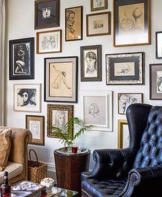 Art wall of framed figure drawings.