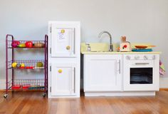 One Cool Christmas Present for Clara | Young House Love. DIY Kitchen which started last Christmas and they added on the fridge and cart this year. So creative!