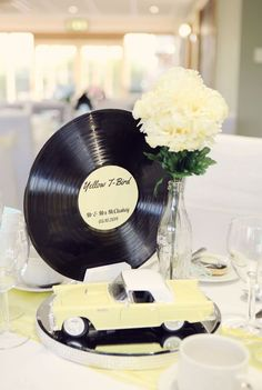 50s Rockabilly Centerpiece with Vintage Car, Coke Bottle, and Record – featured on Rock n Roll Bride