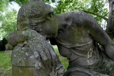 Grieving woman, sculpture in stone, cemetery of St. Mary Nikolai parish, Prenzlauer Berg district, Berlin, Germany, Europe