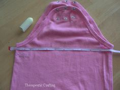 how to turn a Onesie into a t-Shirt-- I knew this had to be possible.  I hate onesies!
