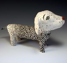 Spotted White Puppy Exquistely painted, hand sculpted ceramic puppy. This piece is one-of-a-kind. This puppy stands 6 tall, It is 10 front to back, and 5.5 wide. Perfect as a gift or for your own personal decorating This little gal has had all her shots and is totally house