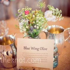 I'm in love with wildflowers and the miniature pewter(esque) pitchers.  Now, where can I find people to gather enough wildflowers for me on my wedding day. . .