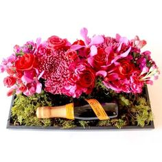 Mid-Range (like the photo)$115.00 A little bottle of Prosecco with a lovely rich floral arrangement presented in a tray box with put a smile on her face! Spoil her!   foxgloves flowers victoria bc florist bubbly Art Floral, Prosecco, Image Shows, Floral Arrangements, Floral Wreath, Bubbles, Tray, Presents, Bloom