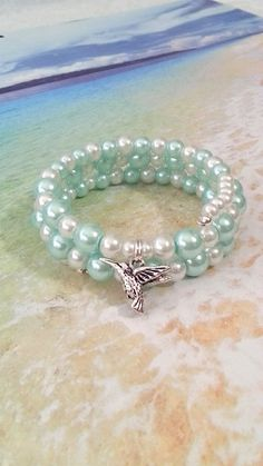 Turquoise and white pearl hummingbird memory by beachseacrafts