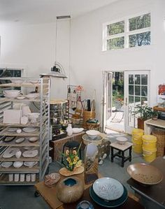 A Home Pottery Studio. Love how hight the ceiling is, it makes it seem more open and which is nice and everything seems less cramped!