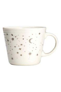 Tazza in porcellana con stampa: Tazza in porcellana con stampa a stelle. Altezza 8 cm, diametro 9 cm.
