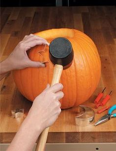 Use a mallet and cookie cutters to carve pumpkins! Gotta remember this!
