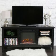 "Features:  -Rich, textured finish.  -Includes electric fireplace insert.  TV Size Accommodated: -60"".  Product Type: -TV Stand.  Design: -Electric fireplace.  Frame Material: -Manufactured wood. Dimen"