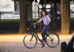 On your bike! Dakota whizzed past on her bicycle as the cameras rolled...