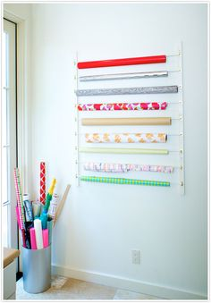diy storage wrapping paper rack wall rack curtain rods for craft room Diy Wand, Craft Organization, Craft Storage, Stationary Organization, Organisation Ideas, Organizing Life, Wall Storage, Organizing Ideas, Storage Ideas
