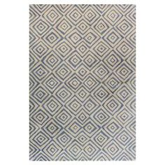 """Anchor your living room seating group or define space in the den with this artfully hand-tufted wool rug, showcasing a concentric diamond motif for eye-catching appeal.   Product: RugConstruction Material: 100% WoolColor: Ivory and blueFeatures: Made in IndiaHand-tufted Pile Height: 0.75"""" Note: Please be aware that actual colors may vary from those shown on your screen. Accent rugs may also not show the entire pattern that the corresponding area rugs have.Cleaning and Care: Regular ..."""
