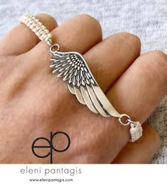 Angel wing bracelet handmade with creme macrame nylon bracelet, angel wing bracelet  #angelwing #angel #wing #wingbracelet #angelbracelet /#macreme #silverbracelet #handmade Angel Wing Ring, Angel Wing Bracelet, Angel Wings Jewelry, Evil Eye Bracelet, Etsy Jewelry, Jewelry Crafts, Beaded Jewelry, Jewelry Accessories, Jewelry Ideas