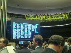 A screen shows the vote tally as activists cheer for the bill from the upper level of the Chamber. Photo shared by Carolina Rossini via Twit...