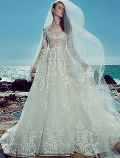 Zuhair Murad Spring/Summer 2017 Couture Bridal Collection - Hong Kong - Long sleeves A-line wedding dress with sparkling embroidery head-to-toe and seductive sheer bodice.