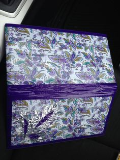PURPLE FEATHER ||This book was created for Shinaya and I wanted to give it some pizzaz so I hand cut out some feathers from silver and purple Duck tape. This picture is a frontal view showing the purple binding. Hand made by The Organized Bean.