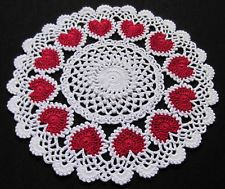 Doily with red hearts.