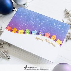 Winter Wonderland – mygirllollipop This morning, I woke up to a scene not that dissimilar to this card. Maybe not the rainbow of houses, but there's a lot of snow! I don't usually get much snow where I live so it was a surprise to l… Homemade Christmas Cards, Christmas Cards To Make, Xmas Cards, Homemade Cards, Handmade Christmas, Holiday Cards, Christmas Diy, Christmas Houses, Scandinavian Christmas