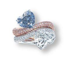 Lot 1827 - A RARE PAIR OF COLOURED DIAMOND AND DIAMOND RINGS