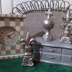 Two days of rain produce reinvigorated smalls...a clock a rattan tray  a jewelry box and a trio of what-nots. #aardvarkfurniture #renivigorateddecor #paintedclocks #fleurdelis #jewelryboxupdate #heirloomtraditionspaint #clockfetish