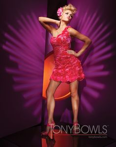 One-shoulder soft satin short sheath with sweetheart neckline and hand-beaded ribbon flower accents.