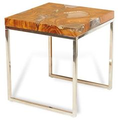 If there was ever a wood that conveyed glamour, it is teak, and if there was ever a finish that achieved the same level of gorgeousness it is most certainly a high gloss.  This beautiful side table brings the best of the best together to create a modern organic effect that exudes pure elegance. #kathykuohome