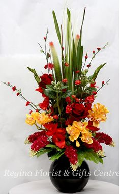 flower arrangements with gladiolus | Cymbidium & Gladiolus Arrangement - Regina Florist & Gifts Centre